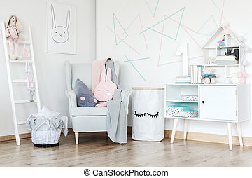 Pastel baby's room with cupboard