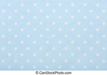 Pastel blue polka dot fabric macro, texture background