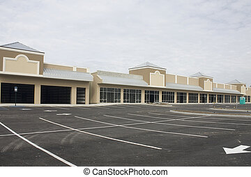pastel brown and beige strip mall