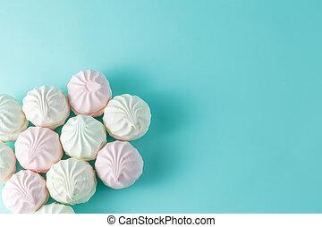 Pastel colored marshmallow on aquamarine bright background