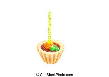 pastel, con, amarillo, vela cumpleaños, blanco