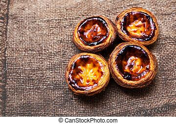Pastel de nata, portuguese traditional creamy pastry. Egg...