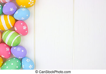 Pastel Easter Egg side border against a white wood background