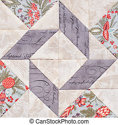 Pastel geometric patchwork block from pieces of fabrics, detail of quilt
