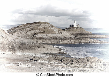 The Mumbles with it's lighthouse as seen from Bracelet Bay on the Gower Peninsular West Glamorgan,Wales UK