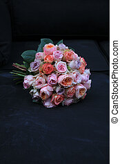Pastel roses in bridal bouquet