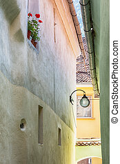 Pastell coloured narrow alley. - String street in Brasov,...