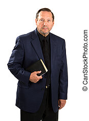 Senior adult pastorial staff in a blue sports coat holds his Holy Bible.