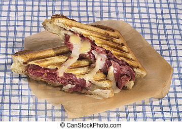 Pastrami sandwich grilled with chedar and manchego cheese -...