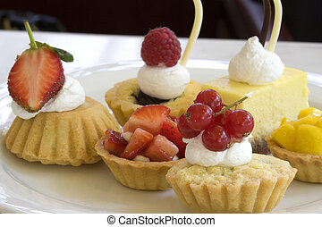 Image of a variety of delicious looking pastries for dessert.