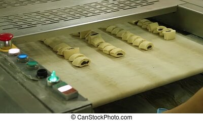 Pastries with poppy in the bakery. - Cookies production line...