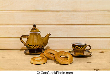 Pastry and tea-set on wooden background