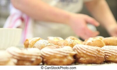 Pastry chef at work prepares sweets in confectionery