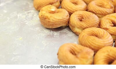 Pastry chef at work with  donuts