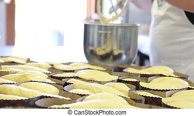 pastry chef hands icing dough for Easter cake doves