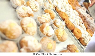 pastry chef prepare sweets sprinkle with icing sugar in...