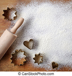 pastry cutters on wooden cutting board