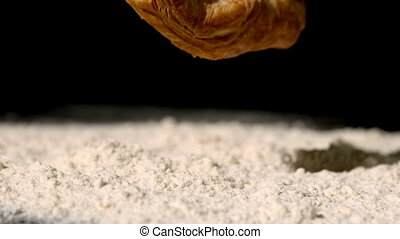 Pastry snack falling on flour