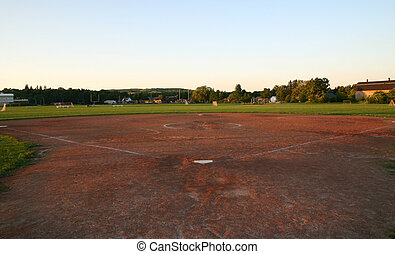 pasttime - An empty baseball diamond - awaiting players.