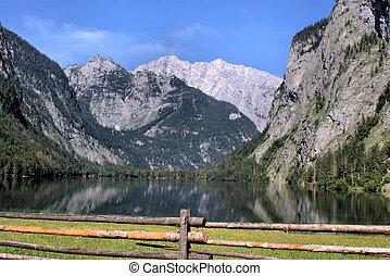 Pasture and mountain lake