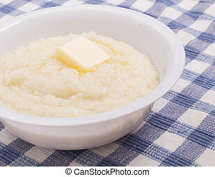 Pat of Butter on Bowl of Grits Closeup - A bowl of white ...