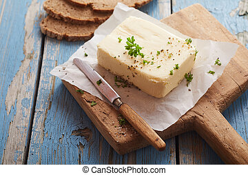 Pat of butter seasoned with fresh herbs, salt and spices on...