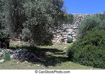 Patara aquaduct - Wall of Patara aquaduct and trees in...