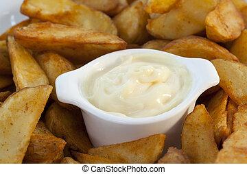 Spanish tapas, patatas bravas with garlic mayonnaise dipping sauce.