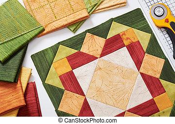 Patchwork orange-green block, quilting fabrics, sewing accessories