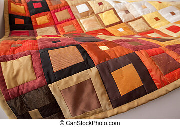 Part of patchwork quilt as background.