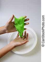 Pate slime elastic and viscous on child's hand - Slime, ...
