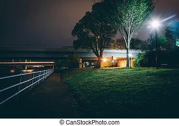 Path and bridges along the Potomac River at night, in Washington, DC.