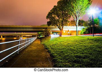 Path and bridges along the Potomac River at night, in Washington