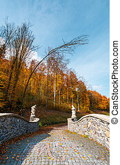path from the in to the autumn forest - path from the stone...