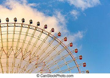 Path of ferris giant wheel against blue sky