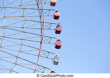 Path of Giant wheel against clear blue sky background