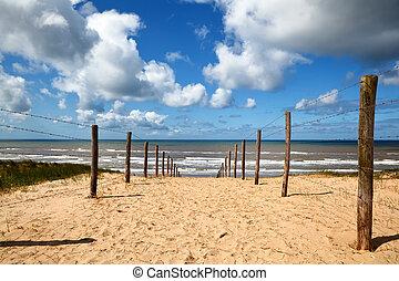 path on sand to the beach on North sea