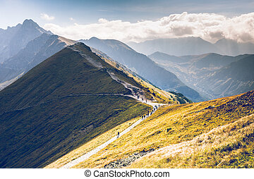Path on the steep side of Kasprowy Wierch in Tatra mountains...