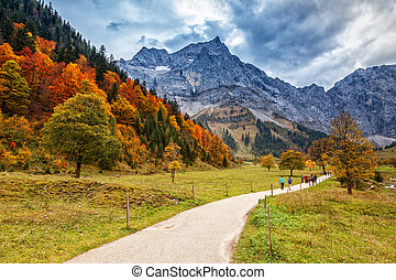 Path through autumn mountain landscape in the Alps, near Engalm. Austria, Tirol.