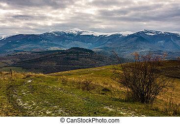 path through hillsides in autumn. landscape of mountain...