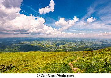 path through the mountain ridge - winding path through large...
