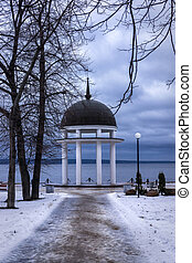 Path to rotunda on lake in winter