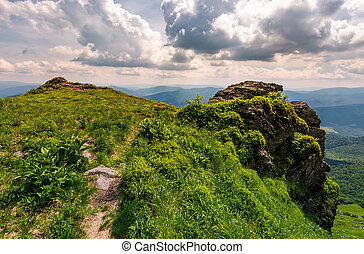 path to the edge of a rocky cliff. beautiful landscape of...