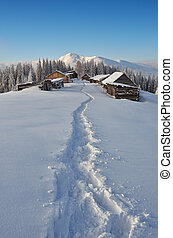 Path to the huts in the mountains - Winter landscape with a ...