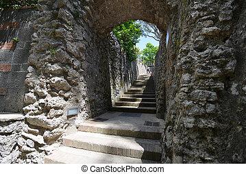 path uphill - narrow path between  walls rises uphill