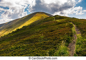 path uphill the mountain ridge. beautiful scenery in fine...
