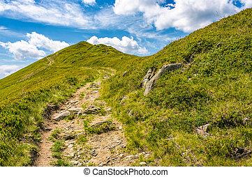 path uphill to the peak of mountain ridge