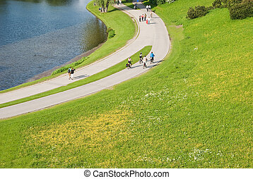 Path with People Walking and Biking in Spring