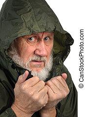 pathetic senior man in green waterproof hoody