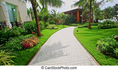 Pathway among Flowers Grass to Pavilion in Hotel Tropical Park